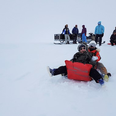 Fun in the snow on the Hardangerfjord in a nutshell winter tour by Fjord Tours - Eidfjord, Norway