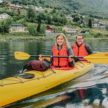 Happy couple in a kayak - Olden, Norway