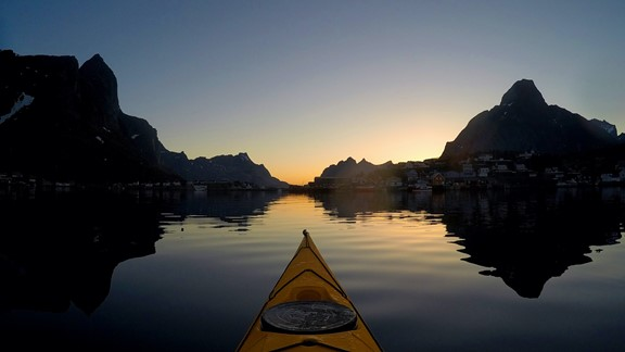 Midnight sun kayaking in Reine in Lofoten Islands - Norway