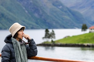 Woman in reflection in the Fjords|Hjordundfjord & Norway in a nutshell® tour
