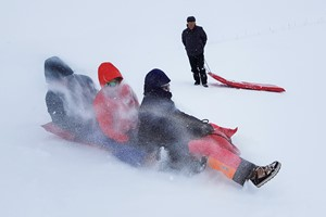 Playing in the snow on the Hardangerfjord in a nutshell winter tour by Fjord Tours - Eidfjord, Norway