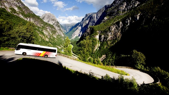 Norway in a nutshell® - bus driving in the most steepest roads in Europe, the famous Stalheimskleiva hairpin bens | Plan and book with Fjord Tours