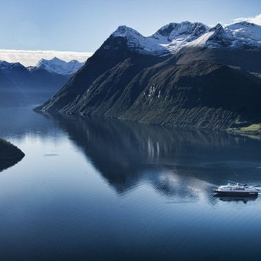 Experience the magical Hjørundfjord and Hurtigruten on the Hjørundfjorden & Norway in a nutshell® tour by Fjord Tours
